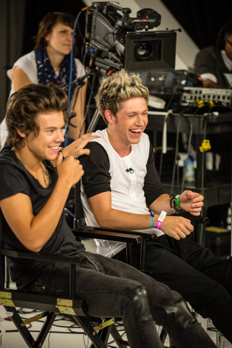 """LONDON, ENGLAND - AUGUST 19: (L-R) Liam Payne and  Niall Horan behind the scenes at the photo call and press conference for """"One Direction This Is Us"""" at Big Sky Studios on August 19, 2013 in London, England. Photo by Cal Auran"""