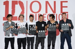 "LONDON, ENGLAND - AUGUST 19: (L-R) Louis Tomlinson, Niall Horan, Zayn Malik, Liam Payne, Harry Styles and Morgan Spurlock attend a photo call and press conference for ""One Direction This Is Us"" at Big Sky Studios on August 19, 2013 in London, England. (Photo by Ian Gavan/Getty Images for Sony Pictures)"