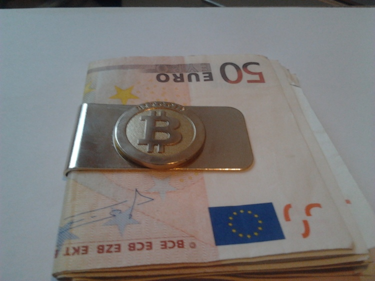 Money clip, woth some odd pieces of paper I found in my pocket. Bitcoin money clip with money. LicenseSome rights reserved by BTCrig