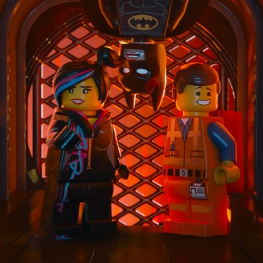 """LG-FP-175 Film Name: THE LEGO® MOVIE Copyright: (C) 2014 WARNER BROS. ENTERTAINMENT INC. Photo Credit: Courtesy of Warner Bros. Pictures Caption: (L-r) LEGO® minifigures Wyldstyle (voiced by ELIZABETH BANKS), Batman (WILL ARNETT) and Emmet (CHRIS PRATT) in the 3D computer animated adventure """"The LEGO® Movie,"""" from Warner Bros. Pictures, Village Roadshow Pictures and Lego System A/S. A Warner Bros. Pictures release."""