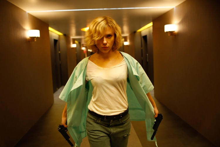 Writer/director Luc Besson directs SCARLETT JOHANSSON in Lucy, an action-thriller that examines the possibility of what one human could truly do if she unlocked 100 percent of her brain capacity and accessed the furthest reaches of her mind.  Credit: Jessica Forde