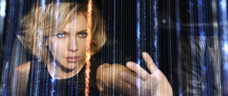 Writer/director Luc Besson directs SCARLETT JOHANSSON in Lucy, an action-thriller that examines the possibility of what one human could truly do if she unlocked 100 percent of her brain capacity and accessed the furthest reaches of her mind.  Credit: Universal Pictures